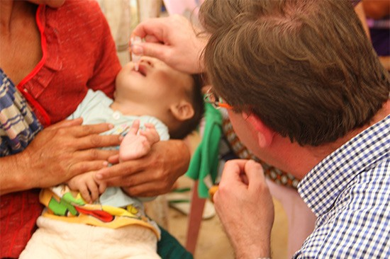 MP vaccinates Lao Child