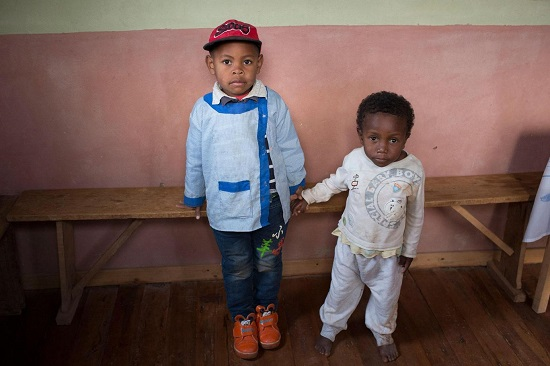 Two boys born on the same day but of very different heights due to malnutrition