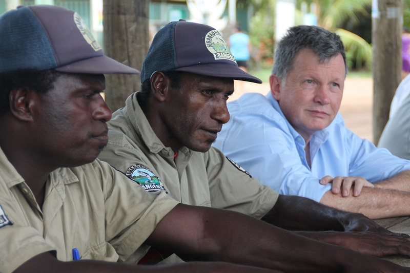 Murray Proctor (RESULTS) talking with members of the INLOC Ranger Taam
