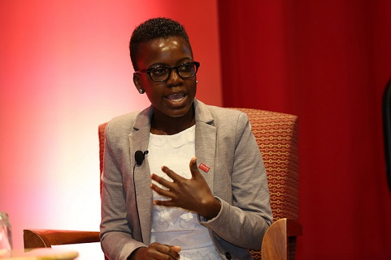 Loyce Maturu speaking onstage at the RESULTS International Conference